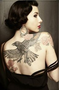 Eagle and flower on back - 50 Awesome Back Tattoo Ideas