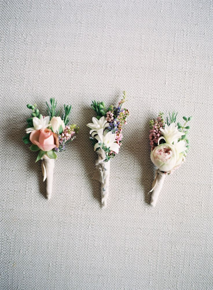 Not the right colors, but I LOVE the style of the boutonnieres. Baby rose, dried flower, greenery.