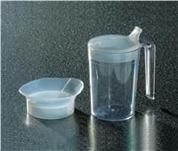 This clear plastic (polycarbonate) mug has a large handle and two interchangeable lids.One has a drinking spout, and the other is anti-spill.