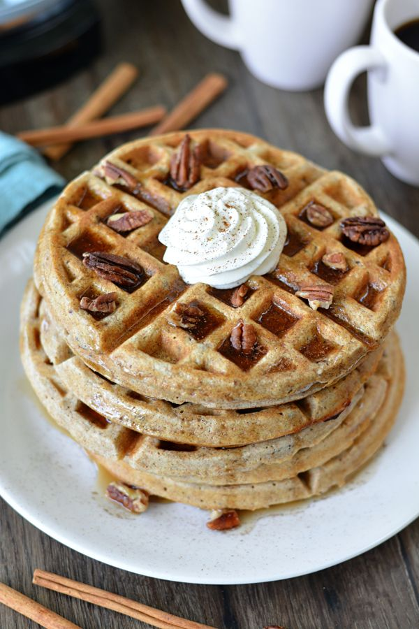 These waffles are loaded with cinnamon and topped with pecans and maple syrup.