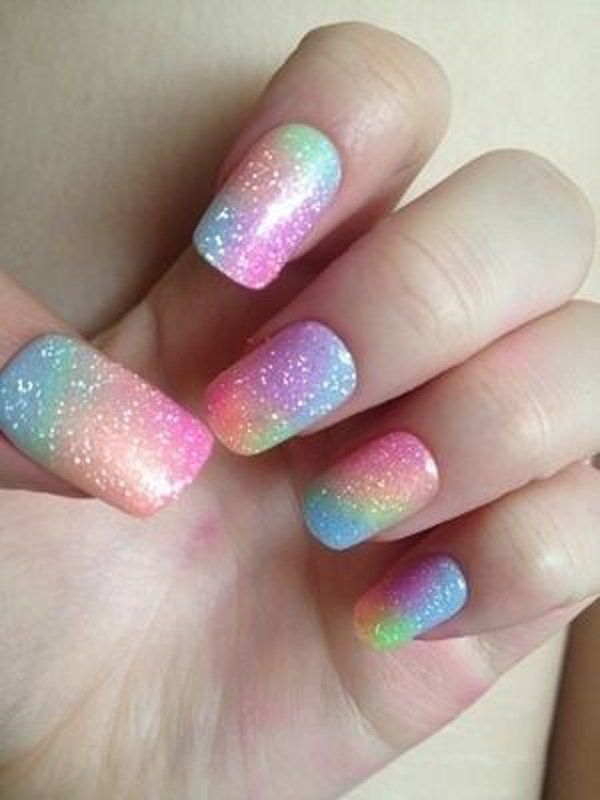 Rainbow colored gradient nail art frosted with silver dust sparkles on top.