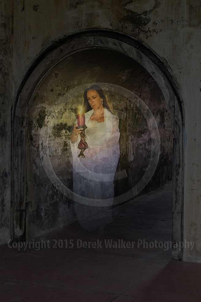 A ghost with a candle drifts down a rundown corridor. For image licensing enquiries, please feel welcome to contact me at derekwalker73@bigpond.com  Cheers :)