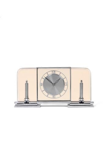 An Art Deco chrome and glass mantel timepiece Le Coultre for Garrards