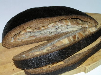 Kalakukko (Finnish meal made of rye bread with small fish, like smelts, cooked inside the bread.)