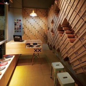 Footwear+store+interior+covered+with+stacked++shoe+boxes+by+Move+Architects