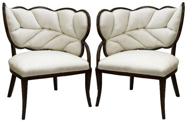 French Art Deco: Circa 1930's A mirrored pair of generously proportioned French Art Deco mahogany framed chairs, the back of curved leaf form upholstered to simulate veins, the stem forming a single arm with upholstered seat resting on two carved squared, tapered front legs and two unadorned squared rear legs.