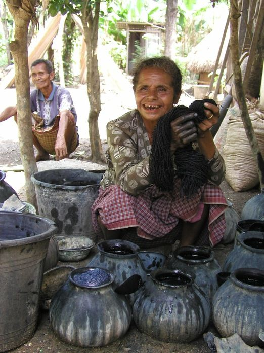 Paint it blue: Oenenu from West Timor after dying a fabric using the Indigo plant. (Photo courtesy of Threads of Life)