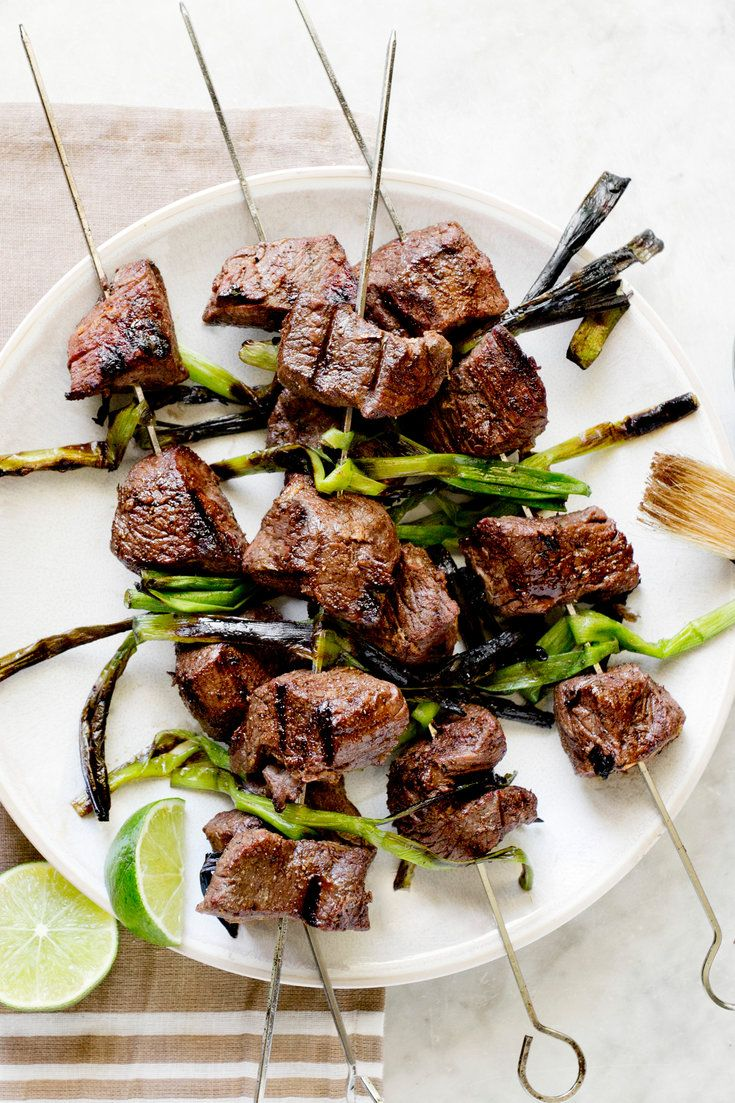 Here is a somewhat different take on lamb kebabs for the grill. The meat is bathed in a spicy-cool Asian marinade and threaded on skewers with whole scallions placed crosswise so all can be seared together. (Photo: Rikki Snyder for The New York Times)