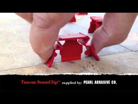 Tuscan SeamClip Tile Leveling System: http://www.stonetooling.com/ProductComparison.asp?ProductCode1=40.73...