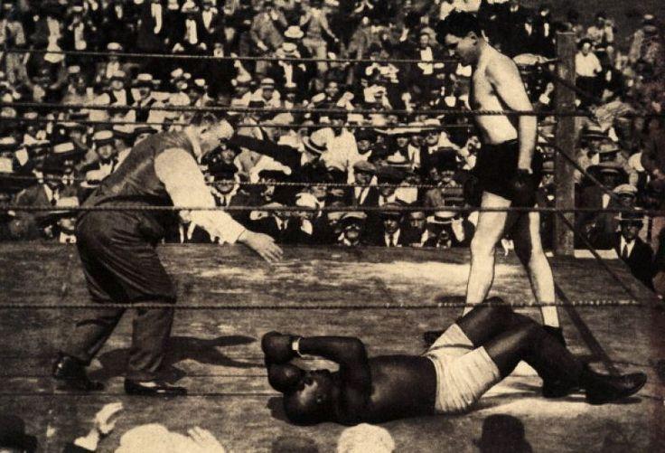 Heavyweight boxer Jess Willard (right) wins the world championship after his opponent, Jack Johnson