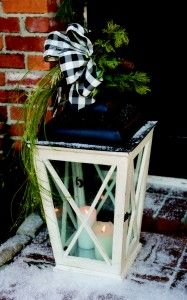 I've been looking for a way to dress up one of my lanterns.  Love the black and white ribbon with the greenery.