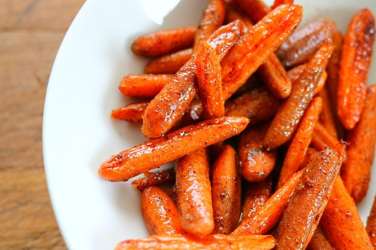 Normally I boil carrots on the stove and add some butter but this recipe for Honey Glazed Oven Roasted Carrots is our new favorite.