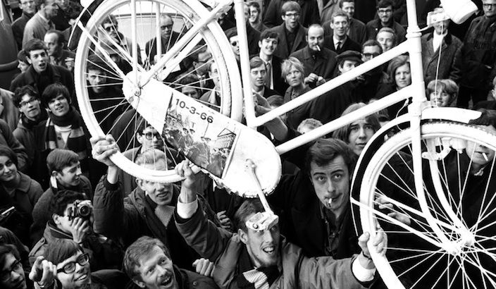 "In the summer of 1965, Dutch designer and political activist Luud Schimmelpennink suggested a simple radical scheme that would eventually change the world. Schimmelpennink had an idea for creating a more sustainable environment by giving away free bicycles for communal use in Amsterdam's city center. The suggestion was called the ""White Bicycle Plan"" and was part of a series of ""White Plans"" devised by the Dutch anarchist group Provo.   Provo is a Dutch word for ""young trouble-maker"" and was…"