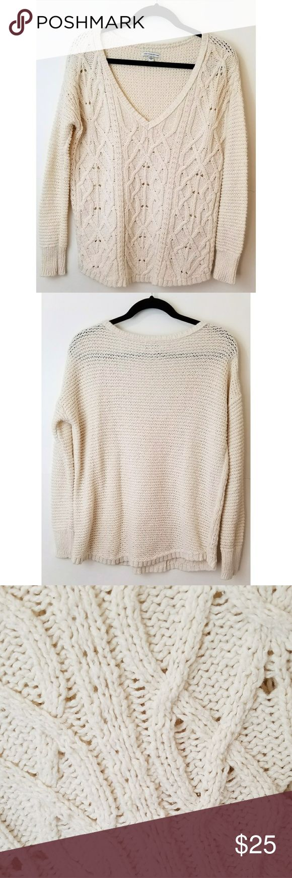"American Eagle Cable Knit Sweater Ameican Eagle Outfitters, off-white color, chunky cable knit, v-neck sweater, great condition, size medium.  Measurements laying flat- 22"" bust 25"" long American Eagle Outfitters Sweaters V-Necks"