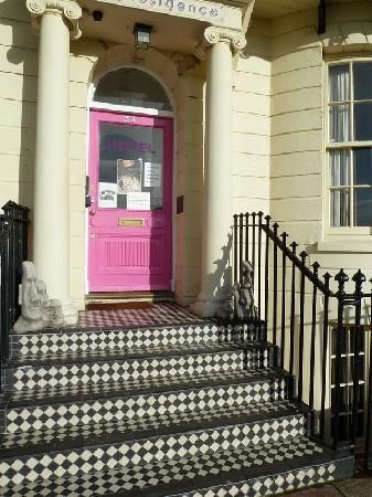 Artist Residence Brighton, #England: Cool black and white #tile on steps, bright pink front door