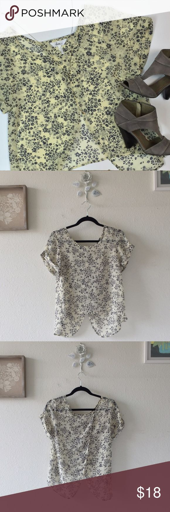 Open Back Print Top Cream short sleeve top with dark navy print. Open flaps in back. Sheer. Shorter in front than back. Cuffed short sleeves. Worn. Good condition. No trades. Kirra Tops Blouses