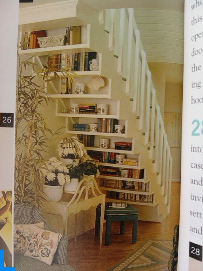Awesome shelf idea for under the stairs, or I think it could be done on a slanted wall (such as a loft affected by the roof).