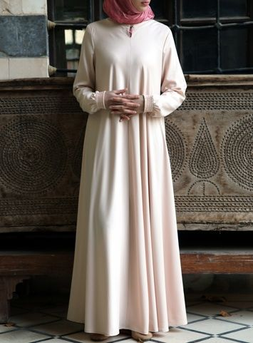 Easy Care Flared Abaya Creme Brûlée color asked for it, and we are happy to oblige: Finally, a wrinkle-resistant version of our popular abayas! The name says it all, and it's as easy to wear as it is to care for. Elasticized sleeves, a front opening, and the perfect flattering, feminine flair work together to create one beautiful, practical piece you'll be reaching for day after day.