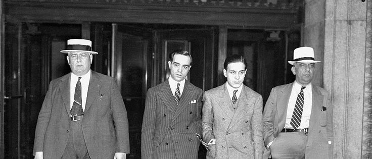 JUNE 05, 1937: Handcuffed together are James Plumeri aka Jimmy Doyle and Johnny Diognardia as they leave court after session. There is nothing delicate about Racketeer Plumeri who is on trial for conducting a trucking shakedown that earned him a small fortune.
