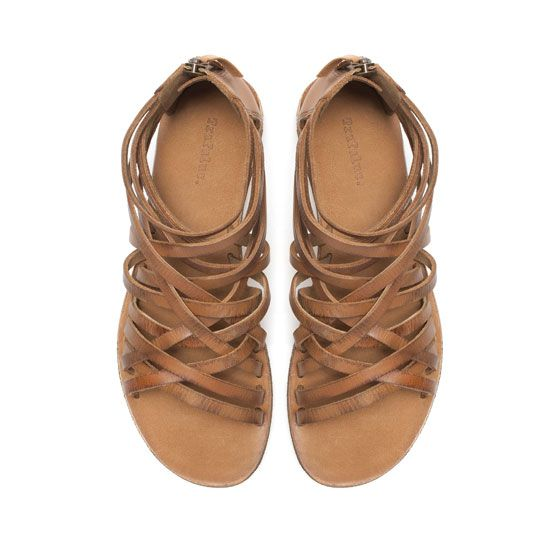 I like flat, strappy sandals.  I prefer to have something (like a strap) covering the side of my foot - outside middle part.