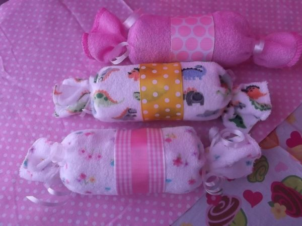 Baby Candy Diaper and  Washcloth Gift Set  Sweet diaper candies ! Perfect baby shower favors or a cute addition to any baby shower gift    Candy rolls are made of 2 pampers diapers & 1 baby washcloth  wrapped in cute matching ribbon by belinda