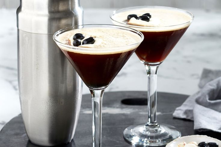 Espresso martini  • 1/2 cup espresso • 90 ml Kahlua • 90ml vodka • 1/2 cup ice cubes • Thickened cream, lightly whipped • Jelly Belly jelly beans (Licorice, Coconut and Toasted Marshmallow)