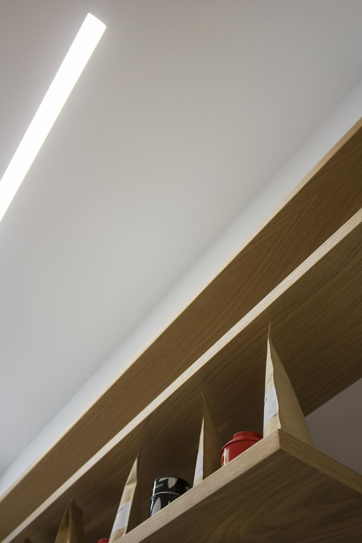 Cafe design, oak shelves, trim less light