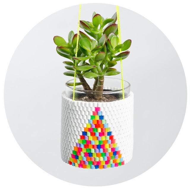 spanish plastic rainbow potplant holder. coolay!