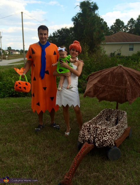 Fernando: Fernando impersonating Fred, Daniela impersonating Wilma, and baby Martina as pebbles. We are one exited family celebrating our babies 1st Halloween!!! Yabba dabba doo!! All costumes hand made by mom...