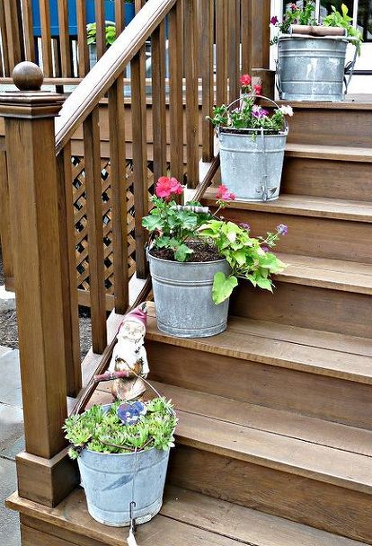 finally a good use for an old mop bucket anyone have other creative planter ideas, decks, gardening, Mop Bucket Planters in a Row Click link for more pics
