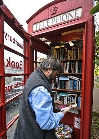 The red phone box that has become Britain's smallest library in westbury-sub-mendip. on the corner of Free Hill. Wow,
