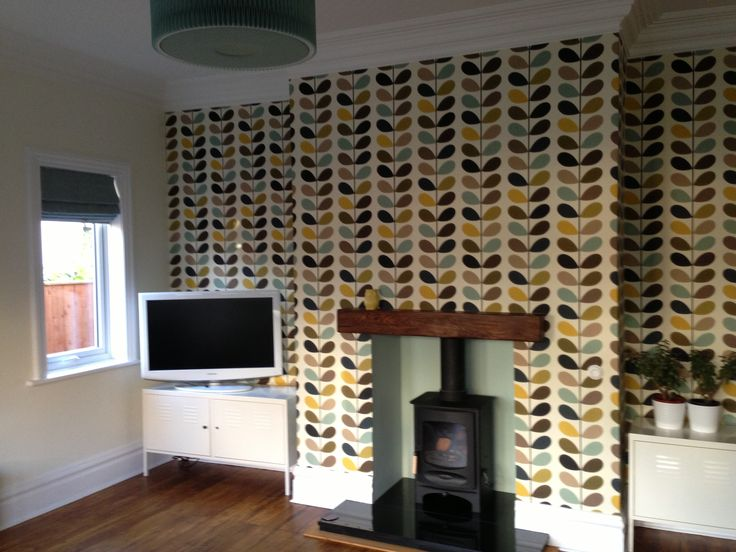 Our Lounge with Orla Kiely wallpaper and log burner