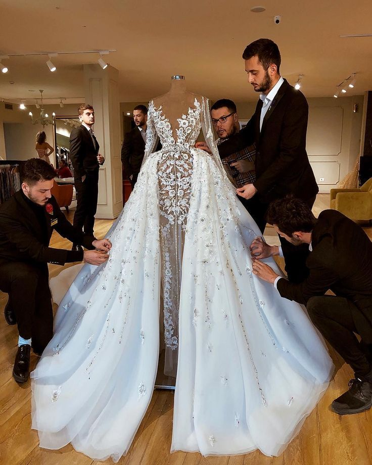 Sparkly Luxurious African 2019 Wedding Dresses Lace Beaded Sheath Bridal Dresses Long Sleeves See Through Wedding Gowns