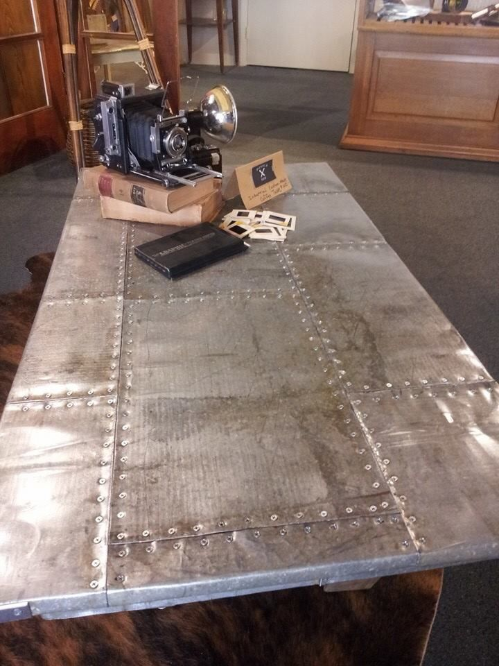 """V form leg coffee table with 12"""" turnbuckles between legs. Reclaimed sheet metal on top"""