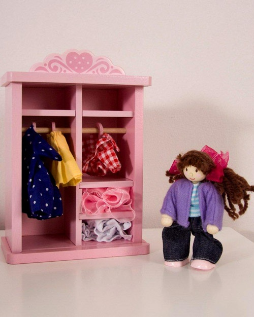 Dress-up Wardrobe – 140mm x 80mm x 190mm high – The perfect pink wardrobe with numerous outfits and a pose-able doll as pictured.  Secured with a Perspex door, it is scaled for all Le Toy Van Doll's houses
