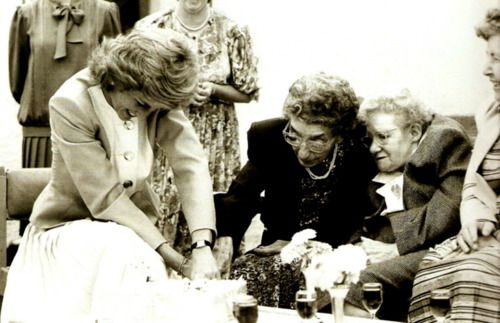 Princess Diana helping cut a birthday cake in 1988.