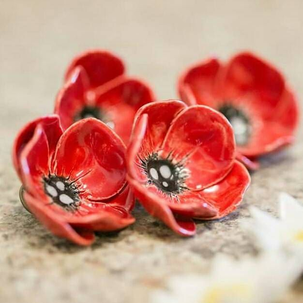 Gorgeous bright red ceramic Poppies! These flowers are hand built from earthenware clay by myself, kiln fired and hand painted with glaze. They are very cute and measure about 3- 4 cm across and have a pin attached to the back... If I have overcharged on postage for international buyers..I will reimburse you the difference. Apologies to international buyers..starting price for a package in australia is high..but you can order up to 500g of brooches for the same price!!! Please note... so...