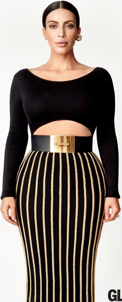 Kim Kardashian wearing a Baja East bodysuit, Balmain skirt, Vionnet belt, Lynn Ban for Donna Karan ear cuff, and Jennifer Fisher studs.