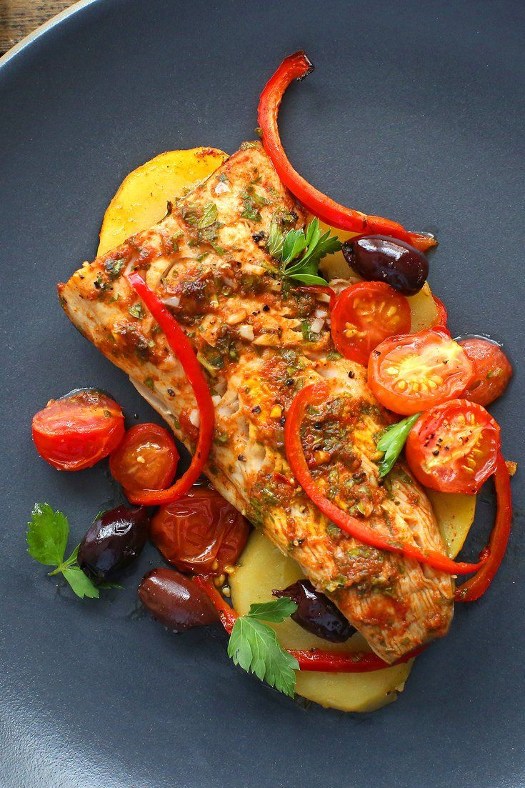 NYT Cooking: Bake fish Moroccan-style with spices, herbs, tomatoes and olives. This easy all-in-one recipe can be served immediately or at room temperature, making it perfect for a dinner party. Double or triple it if you'd like, and include it as part of a buffet. With a good bottle of wine, it will feel just like summer.