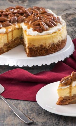 Praline Apple Pie Cheesecake -Three Southern favorites in one. A smooth and creamy cheesecake sits on top of an apple pie. Then the whole decadent thing is topped with a pecan praline caramel sauce. Perfection for parties - especially during the holiday season. This beautiful dessert will wow your guests and have them asking you for the recipe. A sweet treat that will make your get together legendary.