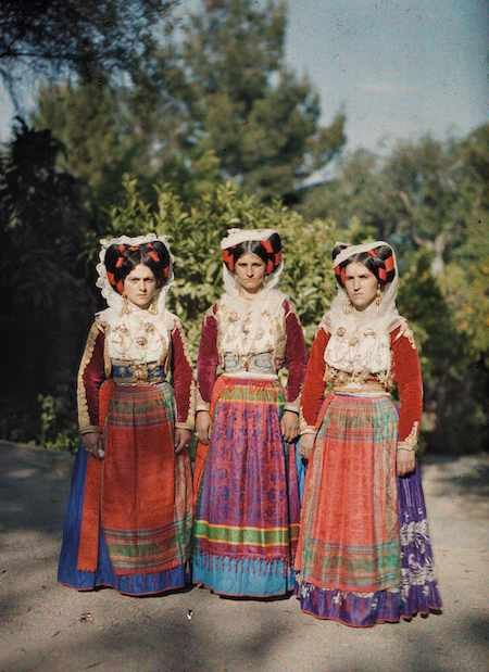 In 1912 and 1913, the years of the First and Second Balkan Wars, photographer Auguste Léon framed a costumed trio on Corfu, a region seemingly untouched by conflict.