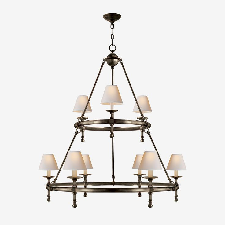 The Classic Ring Chandelier in Bronze with Natural Paper Shades by E.F. Chapman • This feature light bridges traditional and contemporary with its detailed finishes, paper shades, and graceful candlestick-inspired fixtures. Available in single and double tier and work perfectly over dining and living areas or perfect for that stately library look.