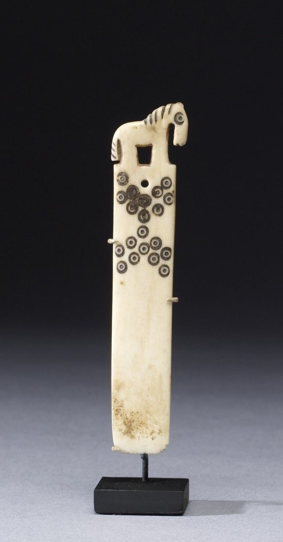 Peruvian weaving tool depicting a horse, bone, ca. AD 200 - 1520 (?)