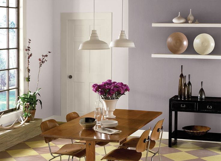 Benjamin Moore Paint Colors - Purple Dining Room Ideas - Elegant Monochromatic Purple Dining Room - Paint Color Schemes . . . . . Two shades of purple pair well to create a cozy dining space. . . . . . Accent Wall (by shelves) - Mauve Desert (2113-50); Walls (by window & door) - Venetian Marble (2114-70); Accent (flower blooms) - Summer Plum (2074-20).