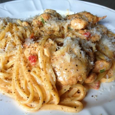 Creamy Cajun Chicken Pasta Need: 2 boneless skinless chicken breasts, cut into thin strips; 4 oz linguine, cooked al dente; 2 tsp cajun seasoning; 2 tbsp butter; 1 thinly sliced green onion; 1 -2 c. heavy whipping cream; 2 tbsp chopped sun-dried tomatoes; 1/4 tsp salt; 1/4 tsp dried basil; 1/8 tsp ground black pepper; 1/8 tsp garlic powder; 1/4 c. grated parmesan cheese.