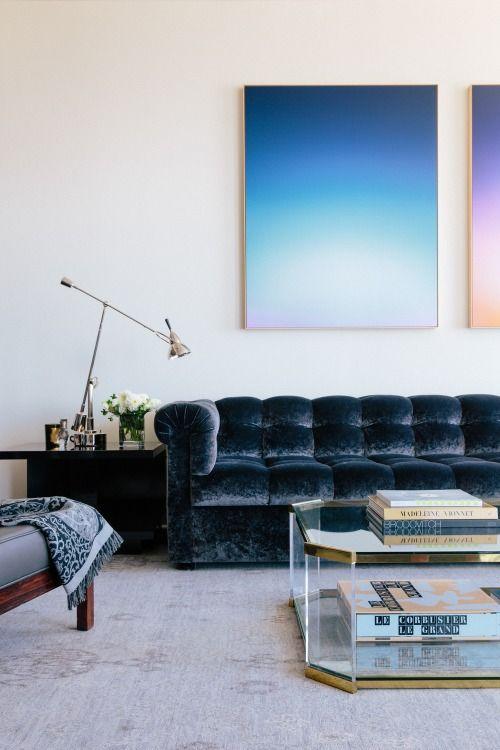 An indigo velvet sofa.