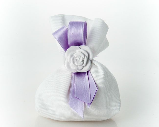 Finest quality organza sachet filled with Jordan Almond candies and soft filling, hand made Capodimonte ceramic flower composition.