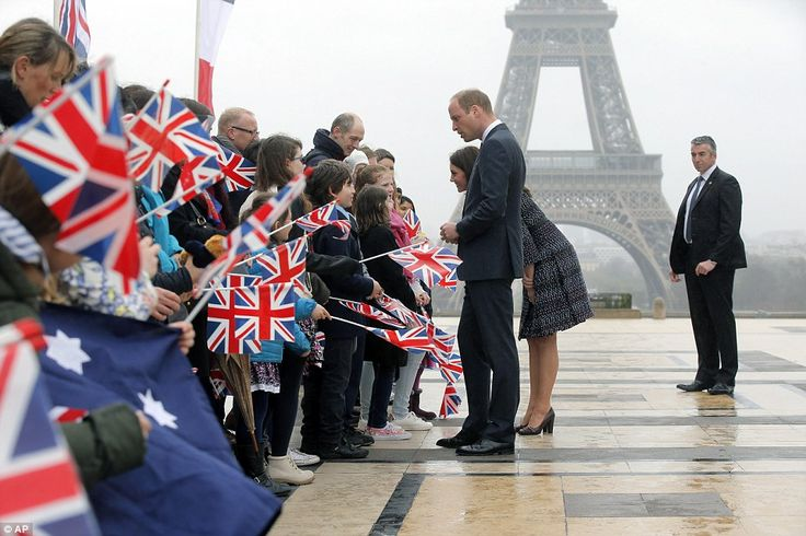 Britain's Prince William, the Duke of Cambridge, and his wife Kate, the Duchess of Cambridge, are welcomed by school children and students from the British Council's Somme project