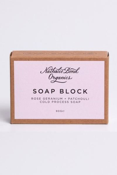Natalie Bond Rose Geranium Patchouli Soap Block: Natalie Bond Rose Geranium & Patchouli Soap Block Combining the light and floral scents of rose geranium with earthy patchouli, the Rose Geranium + Patchouli Wash Block is both sweet smelling and bursting with benefits for your skin. And, it is vegan friendly, handmade in small batches and packed with natural ingredients.