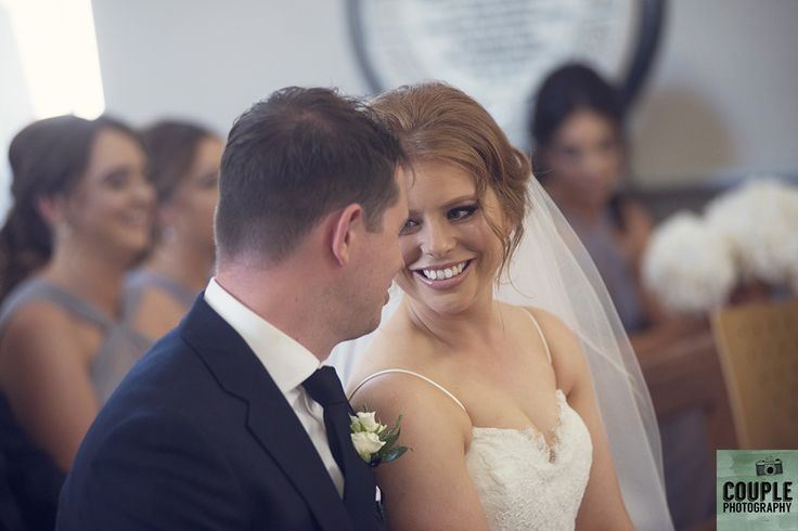 The bride & groom during their wedding ceremony. Weddings at Druids Glen Hotel by Couple Photography.